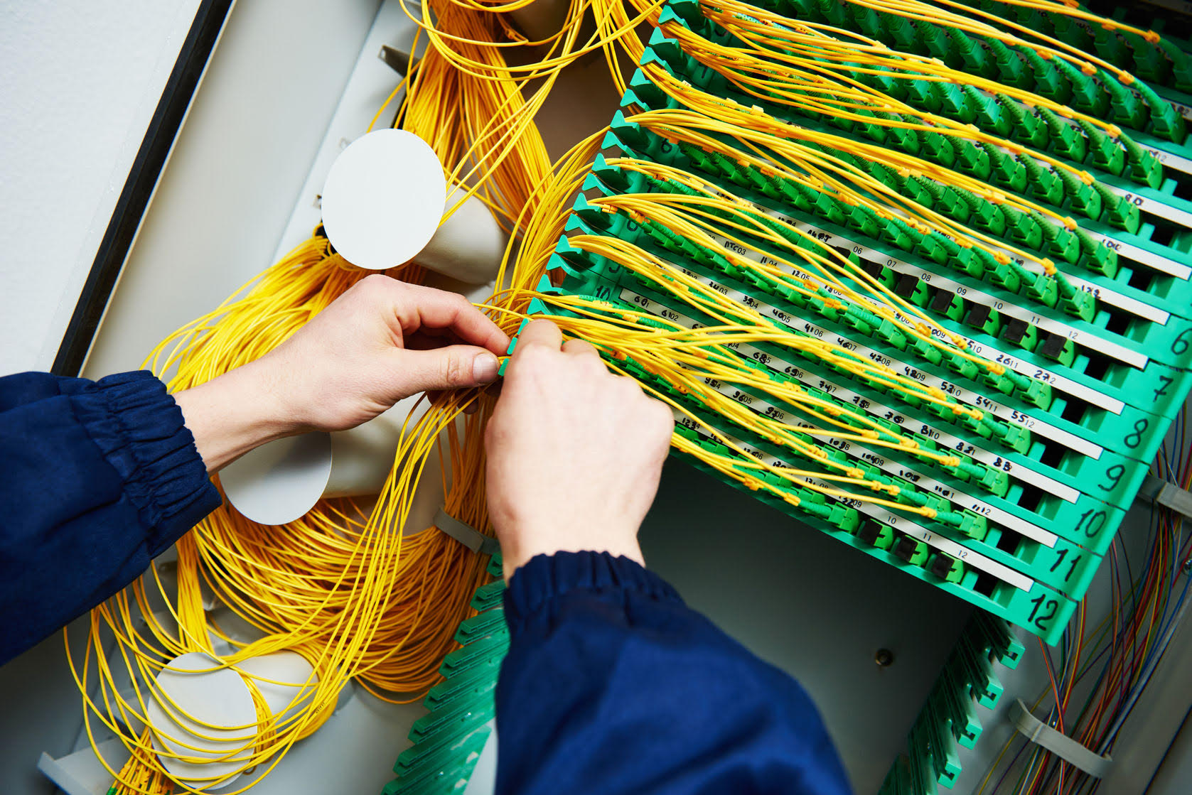 65564819 - internet connection. technician engineer hands connecting fiber optic cables